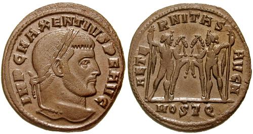 Moneta romana di Massenzio con i Diòscuri raffigurati sul retro